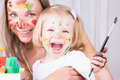 Happy mother and daughter painting Royalty Free Stock Photo