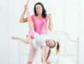Happy mother and daughter playing in bad Royalty Free Stock Photo