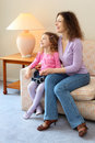 Happy mother and daughter sit on couch Royalty Free Stock Photography