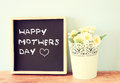 Happy mother day written on chalkboard,