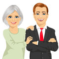 Happy mother embracing her son dressed in business suit standing with arms folded Royalty Free Stock Photo