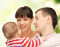 Happy mother and father with adorable baby picture of focus on man Stock Photos