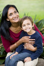 Happy mother with five year old son on lap Stock Photos
