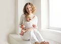 Happy mother with her baby having fun together at home Royalty Free Stock Photo