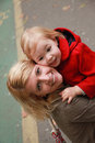 Happy mother with her little daughter in her arms in the park, i Royalty Free Stock Photo