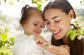 Happy mother and her little daughter in the spring day Stock Images