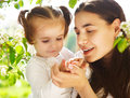 Happy mother and her little daughter in the spring day Royalty Free Stock Image