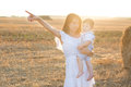Happy mother and her little son in the field. Royalty Free Stock Photo