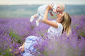 Happy mother and her little son phaving fun in a lavender field Royalty Free Stock Photo
