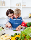 Happy mother and her son cooking Stock Image