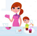 Happy mother with her son cooking in the kitchen Stock Images