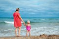 Happy mother and his little daughter at beach adorable Stock Photo