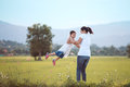 Happy mother holding her kid and spinning around with fun Royalty Free Stock Photo