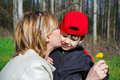 Happy mother hug son with dandelion outdoor Stock Images