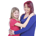 Happy mother hugging her daughter with braces isolated on white Stock Photo