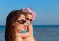 Happy mother and kid looking on blue sea closeup portrait Stock Image