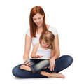 Happy mother with little girl and tablet pc Stock Photos