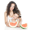 Happy mother and little girl with watermelon Royalty Free Stock Images