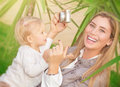 Happy mother photographing baby Royalty Free Stock Photo
