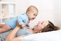 Happy mother playing with adorable baby her daughter Royalty Free Stock Photography