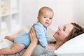 Happy mother playing with adorable baby her daughter Stock Image