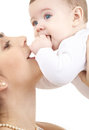 Happy mother playing with baby boy picture of over white focus on Stock Photos