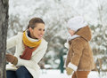 Happy mother playing with baby in winter park high resolution photo Stock Images