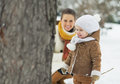 Happy mother playing with baby in winter park high resolution photo Royalty Free Stock Photos