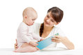 Happy mother reading to baby a book Royalty Free Stock Photos