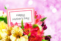 Happy mother s day tag among a bouquet of flowers with twinkling background Royalty Free Stock Photography