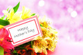 Happy mother s day tag among a bouquet of flowers with twinkling background Royalty Free Stock Photo