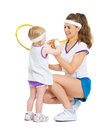 Happy mother showing baby medal for achievements in tennis isolated on white Stock Images