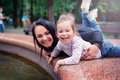 Happy mother and small daugher in a park Royalty Free Stock Photo