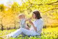 Happy mother and son family young her spending time outdoor on a summer day Royalty Free Stock Image