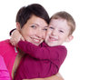 Happy mother and son hugging over white Stock Images