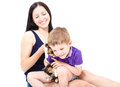 Happy mother and son together with kittens Royalty Free Stock Photo