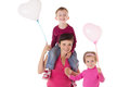Happy mother and two children with balloons isolated on white Royalty Free Stock Photos