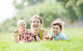 Happy mother with two children at summer park Royalty Free Stock Photography