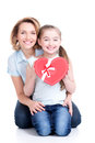 Happy mother and young daughter hold gift for birthday portrait of isolated Stock Photos
