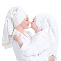 Happy mother and young daughter in white dressing gown portrait of look at each other isolated family people concept Stock Image
