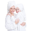 Happy mother and young daughter in white dressing gown portrait of towel isolated family people concept Royalty Free Stock Image