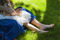 Happy motherhood woman sitting on grass wth little daughter on her hands family relations concept photo with copy space for text Stock Photos