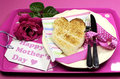 Happy mothers day breakfast tray pink rose heart shape toast polka dot tray vertical Stock Image