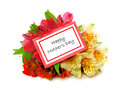 Happy mothers day card among a bouquet of colorful flowers over white Royalty Free Stock Photo