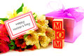Happy mothers day card with colorful flowers gift box and toy blocks Stock Photo