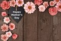 Happy Mothers Day chalkboard heart with flower corner border on wood Royalty Free Stock Photo