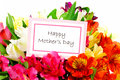 Happy mothers day tag among a bouquet of flowers Royalty Free Stock Image