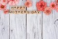 Happy Mothers Day wooden blocks with flower top border on white wood Royalty Free Stock Photo