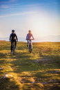 Happy mountainbike couple outdoors have fun together on a summer afternoon Royalty Free Stock Photo