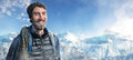 Happy mountaineer has reached the summit Stock Photo